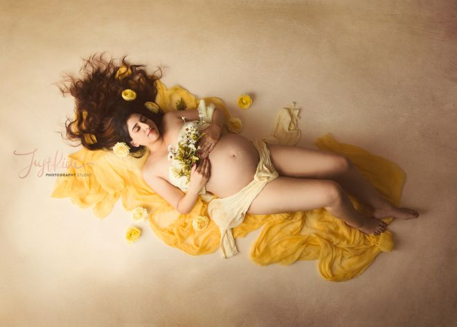 Yellow Bright Moody Maternity Photo with Floral Background